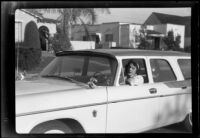 Woman in the driver's seat of an automobile, Santa Monica (probably), circa 1960-1965
