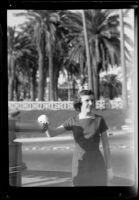 Woman standing beside telescope at Palisades Park, Santa Monica, circa 1960-1965