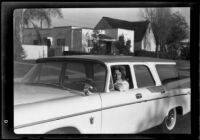 Young woman in a station wagon parked in front of Adelbert Bartlett's house, Santa Monica, 1955-1965