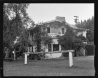 Will Rogers ranch house, exterior view of the north-facing side and hitching post, Pacific Palisades, 1935