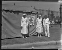 Red cross workers in front of a tent during the funeral of Will Rogers at Forest Lawn, Glendale, 1935