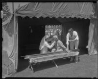 Red cross workers administering first aid in tent during the funeral of Will Rogers at Forest Lawn, Glendale, 1935
