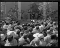 George Jessel speaking at the memorial service for will Rogers at Twentieth Century Fox Studio, Los Angeles, 1935