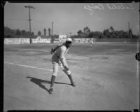 Baseball pitcher Satchel Paige after a pitch, Los Angeles, circa 1933