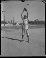 Baseball pitcher Satchel Paige in a baseball field ready to pitch, Los Angeles, circa 1933