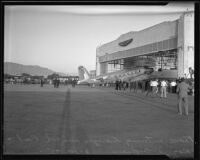 Plane carrying the bodies of Will Rogers and Wiley Post arrives at Union Air Terminal, Burbank, 1935