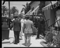 Will Rogers, assisting with arrangements after the death of Florenz Ziegfeld, leaving the Pierce Brothers Mortuary, Los Angeles, 1932