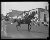 Will Rogers Jr. on horseback in the parade of the Old Spanish Days Fiesta, Santa Barbara, 1930