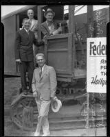 J.B. Irsfeld, Will Hays, Henry B.R. Briggs, and steam shovel operator in steam shovel for Hollywood post office ground breaking, with color guard, Hollywood, 1935