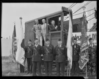 J.B. Irsfeld, Henry B.R. Briggs, and Will Hays in steam shovel for Hollywood post office ground breaking, with color guard, Hollywood, 1935