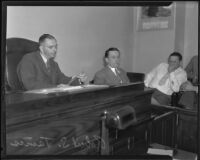 Robert S. James, suspect in Mary Emma James murder case, on witness stand, Los Angeles, 1935