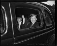 Robert S. James, suspect in Mary Emma James murder case, waving from car window, 1935 or 1936