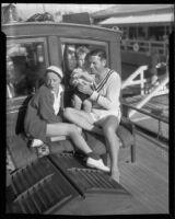 Actors Richard Arlen and Jobyna Ralston Arlen, with son Rickey Arlen, on their boat, Coronado, 1935
