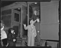 Actor Leo Carrillo, writer Frank Condon, and Los Angeles Chamber of Commerce president Robert L. McCourt boarding a train for Mexico, 1936