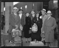 Actor Leo Carrillo, writer Frank Condon, and group near train after return from Mexico, 1936