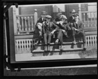 Actor Clark Gable as a young man with group of young men on porch, [Ohio?], [1920s?]