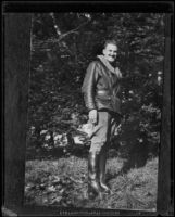Young man in leather jacket in wooded area, [Ohio?], [1920s?]