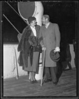 Actors Verree Teasdale and Adolph Menjou on boat deck, 1935-1936