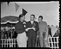 Golfer Jimmy Demaret receiving winner's check from Norman Chandler, Los Angeles Open Golf Tournament, Los Angeles, 1938