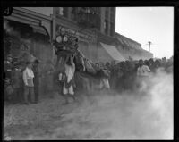 Dancing Chinese lion during festival in Chinatown, Los Angeles, circa 1920-1939