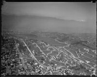 Aerial view of streets, hills, reservoir, and mountains, Los Angeles, [1930s?]