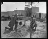 Los Angeles Times oil news editor Howard Kegley and another man at fake grave site, [1930-1949?]