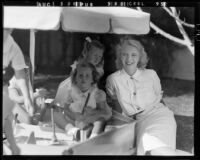 Actress Virginia Bruce, daughter Susan Ann Gilbert, and guest Susan Zanuck at Susan Gilbert's 7th birthday party, [Santa Monica?], 1940