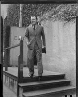 Man walking down steps from doorway, 1927 or 1937