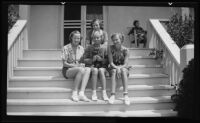 UCLA sorority Gamma Phi Beta members posing on steps with dog, [Los Angeles?], 1936