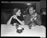 Screenwriter Jack Kirkland and Betty Douglas at table, Beverly Hills, 1937