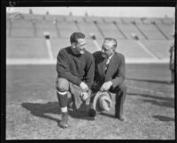 Football player Red Grange and manager C.C. Pyle posing, Los Angeles Coliseum, Los Angeles, 1926