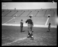Football player Red Grange and 3 other men, Los Angeles Coliseum, Los Angeles, 1926
