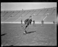 Football player Earl Britton running, Los Angeles Coliseum, Los Angeles, 1926
