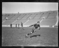 Football player Red Grange running, Los Angeles Coliseum, Los Angeles, 1926