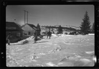 Sled dogs, men, cars, and toboggan in snow, recovery operation, June Lake, 1938
