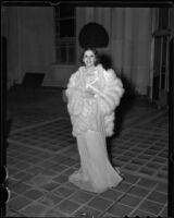 Model Jeannette Warren in chiffon gown and fur wrap, Times Fashion Show, Los Angeles, 1936