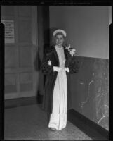Model Diana Gibson in chenille dress and fur coat, Times Fashion Show, Los Angeles, 1936