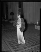 Model in decorated dress and fur wrap, Times Fashion Show, Los Angeles, 1936
