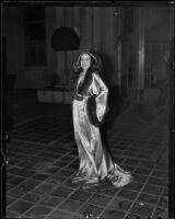 Model Priscilla Lawson in satin and fur negligee, Times Fashion Show, Los Angeles, 1936