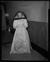 Model in hooded gown, Times fashion show, Los Angeles, 1936