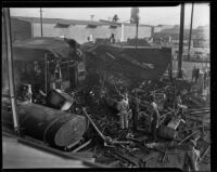Burned buildings and truck, Los Angeles, 1938