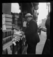 Book stall, probably in the vicinity of the old Los Angeles Times Building, Los Angeles, 1938