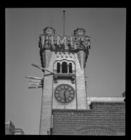 Clock tower of the old Los Angeles Times Building, being prepared for demolition, Los Angeles, 1938