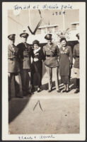 Four men in uniform and two women, World's Fair, Chicago, 1934