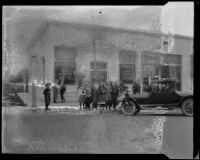 First National Bank, exterior, following robbery, with people gathered, Arcadia, 1922