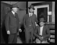 First National Bank robbery suspects Salvadore Mendivil and Brulio Galindo with Deputy Sheriff A.L. Manning, 1922