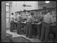Beverly Hills Post Office, interior with men sorting mail, Beverly Hills, 1934