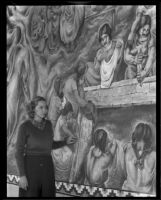 """A young woman looking at the """"Pastoral California"""" fresco by Charles Kassler at Fullerton Union High School, Fullerton, 1934"""