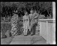 Woman and man seated on stone bench, Palisades Park, Santa Monica, [1930s?]