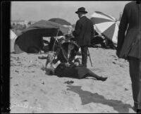 Woman and dog on beach, Long Beach, [1920s or 30s]